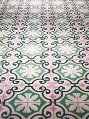 Vintage pink painted floor tiles