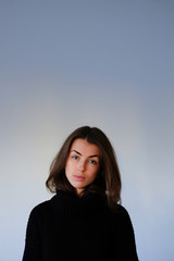 Young brunette in black sweater