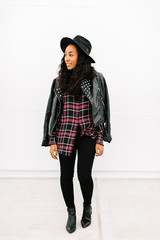 Portrait of an attractive female fashion blogger in trendy clothes
