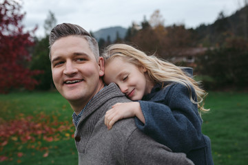 Dad and daughter spending bonding time together in backyard