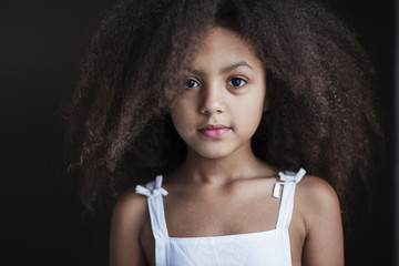 Portrait of a mixed race little girl looking at camera