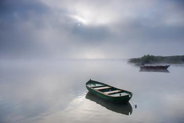 Empty boats at sunrise
