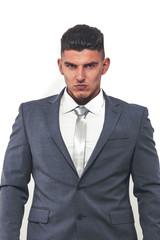Handsome male model in elegant suit posing in studio.