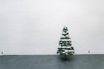 Plastic Christmas tree in an empty room