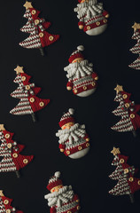 Christmas decorations with christmas motives on balck background.