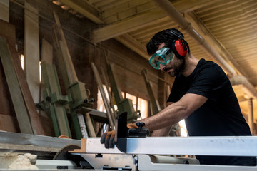 Carpenter polishing a piece of wood