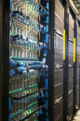 Long bank of servers in server room