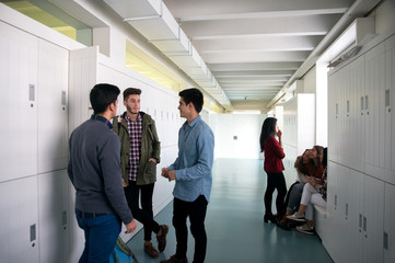 Two group of students on the hall waiting to start  the class