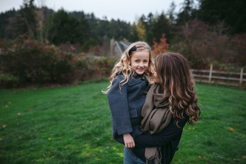 Mom and daughter bonding together in backyard