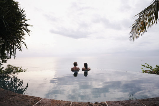 Young  couple relaxing in an infinity pool