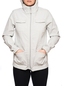 Young woman wearing beige rain jacket isolated on white background