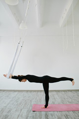 Young woman doing yoga in the gym
