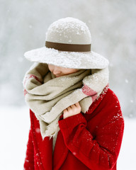 Woman hiding in scarf and hat