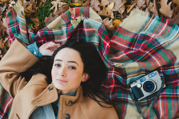 Woman lying on blanket in the park