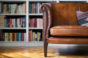 Vintage leather sofa in a classy home library