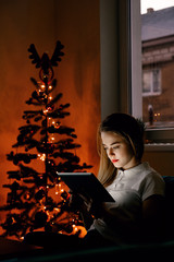 Attractive woman using tablet in the evening