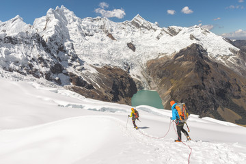Mountain Climbers walking downhill on glacier