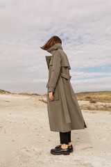 woman with green trench coat outdoors