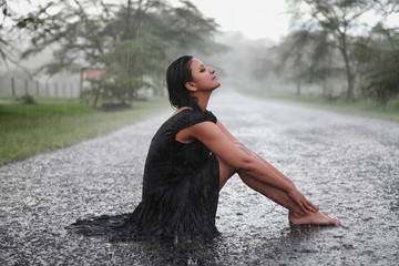 Woman Enjoying the rain