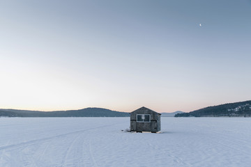 Ice House on Frozen Winter Morning