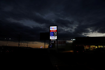 AN iluminated board at the new Mobil gas station is pictured in Queretaro