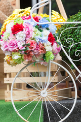 flowers decoration on vintage bicycle