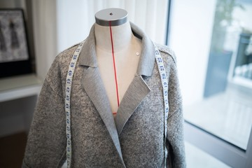 Blazer and measuring tape on mannequin