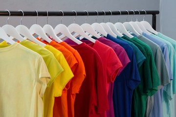 Various t-shirts hanging on cloth hanger