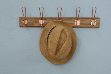 Straw hat hanging on hook