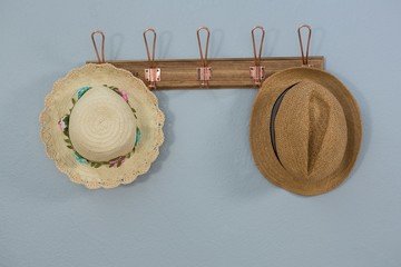 Straw hats hanging on hook