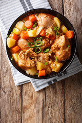 Korean food: Dakdoritang chicken stew with vegetables close-up on a plate. Vertical top view