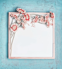 Blank white chalkboard and pretty pastel color flowers bunch on turquoise shabby chic background, top view, frame. Layout for greeting of  Mothers day, wedding, Birthday  or happy event