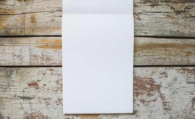 White paper pad on wooden background.