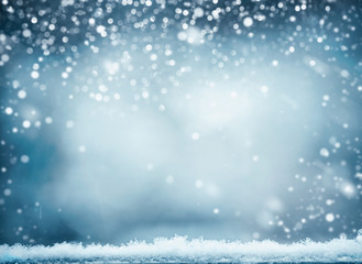 Blue winter background with snow. Winter holidays and Christmas concept