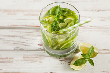 Mojito cocktail on white wood background
