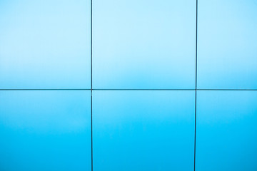 Blue background, business building with the lines on the walls.