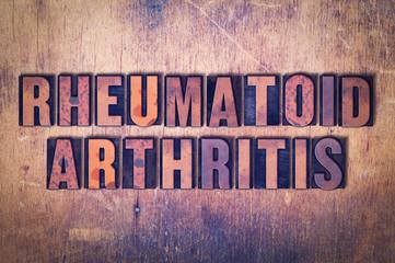 Rheumatoid Arthritis Theme Letterpress Word on Wood Background