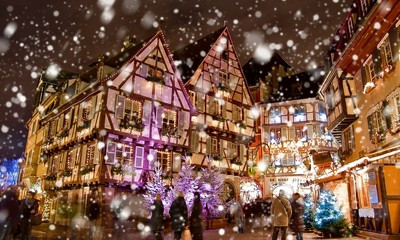 Christmas market under the snow in Colmar, Alsace, France