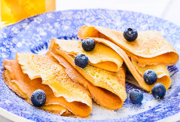 Sweet crepes with berries delicious breakfast plate.