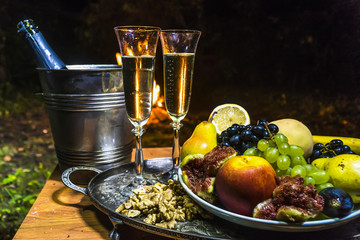 still life with champagne on the background of fire