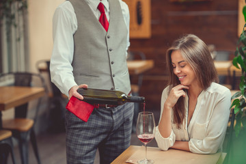 Young woman and waiter