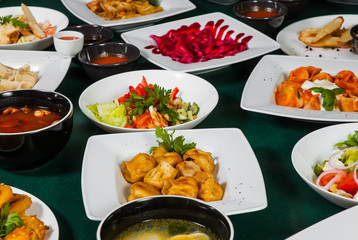 dishes with different food on the table.