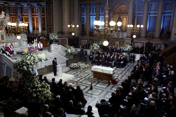 Family members, officials and other mourners attend the funeral ceremony for the late French singer Johnny Hallyday at the Madeleine church in Paris