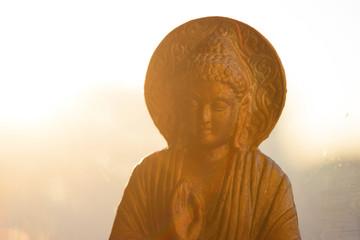 bronze colored buddha statuette