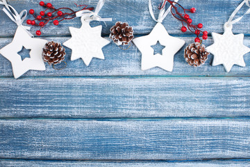 New Year background with berries, stars and with Christmas cones
