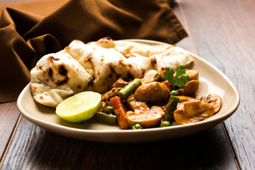 Indian mushroom curry with roti or naan or flat bread, selective focus