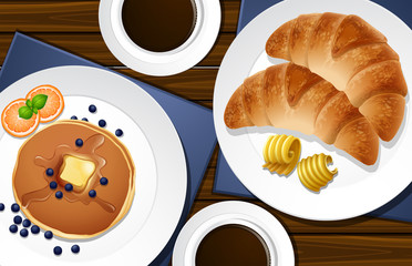 Croissants and pancakes on the table