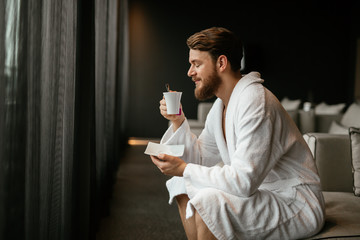 Handsome man drinking tea