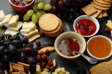 Fruits and cheese snack on slate