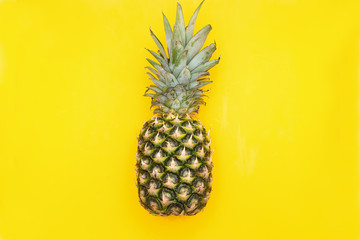 Fresh pineapple on a yellow background. View from above